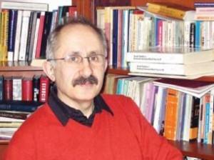 Танер Акчам